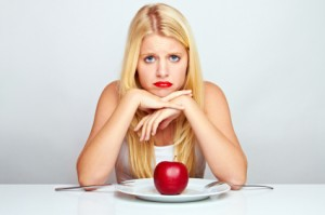 upset-blonde-woman-with-apple-300x199